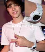 Justin Bieber making his usual peace sign while wering a white Casio G-Shock