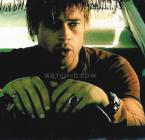 Brad Pitt wearing a Red Monkey Men's Classic watch with black leather strap and