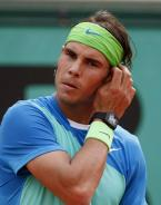 Nadal wearing the Richard Mille RM 027 Tourbillon watch during a tennis game, Ro