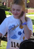 Dakota Fanning wears a ToyWatch Neon Plasteramic Ultra Violet watch
