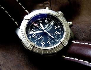 A Breitling Avenger Chrono with the same brown strap and black dial as the versi