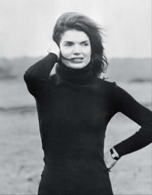 Jackie Kennedy wearing a Cartier Tank Louis with black leather strap