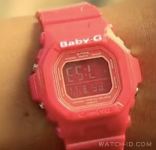 The strangely modified Casio Baby-G, upside down with a digitally added white Ba