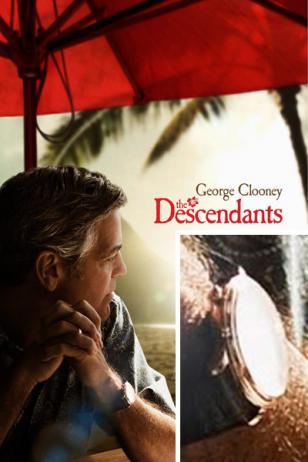 George Clooney wears a gold watch with brown leather strap on the The Descendant