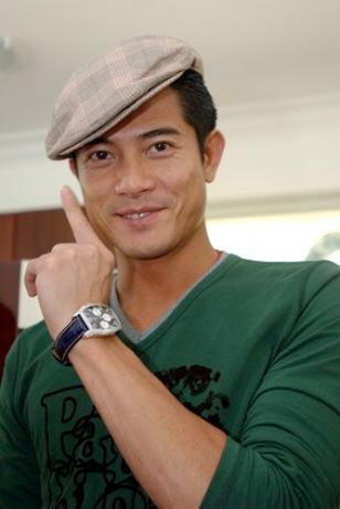 Aaron Kwok showing off a Longines Evidenza watch
