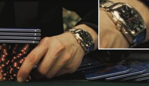 Closeup of Le Chiffre's Longines watch, the Arabic numerals can just be seen