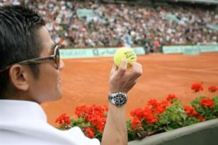 Aaron Kwok wearing a Longines Hydroconquest watch at Roland Garros