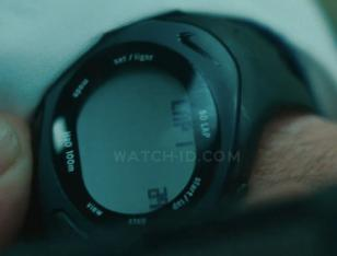 Russell Crowe sets the timer on his Nike Triax Speed 50 Super Watch in the movie
