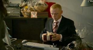 Simon Pegg receiving the gift box containing the Omega watch in How to Lose Frie