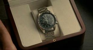 The gift box that Simon Pegg's character receives contains an Omega Speedmaster