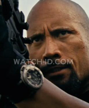 Dwayne Johnson (as Luke Hobbs, an elite FBI agent) wears a Panerai Luminor Subme
