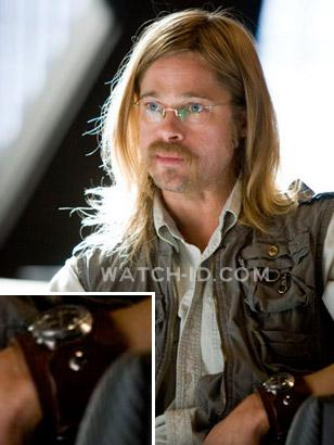 Brad Pitt as Rusty Ryan (in undercover outfit) wearing a watch with custom Red M