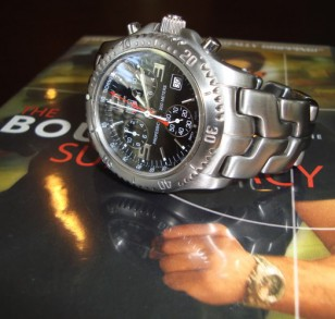 A TAG Heuer Link Chronograph photographed on a Bourne Supremacy DVD box