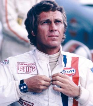 Steve McQueen wearing a TAG Heuer Monaco and his Gulf outfit
