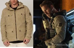 The jacket worn by Ryan Reynolds in 6 Underground is a Belstaff Sand Whitstone Parka.