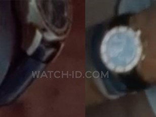 The gold watch has a black strap, gold case and markings on the bezel