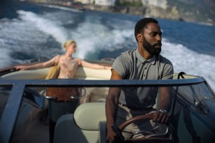John David Washington wears a Hamilton Jazzmaster Seaview Chrono watch in the movie TENET, seen here driving a speedboat with Elizabeth Debicki in the background