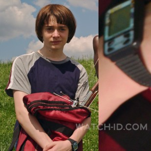 Noah Schnapp wears a Qbert Nelsonic Game Watch in Stranger Things Season 3