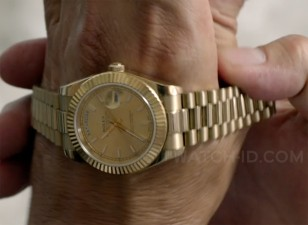 John Travolta, as Ben Aronoff in the movie Speed Kills (2018), receives a gold Rolex Oyster Perpetual Day-Date watch.