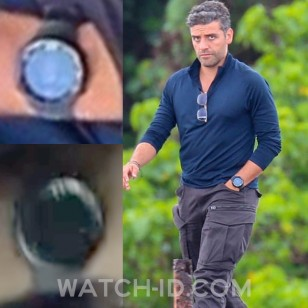 Oscar Isaac (pictured here on the set of the film) wears a Suunto Core All Black SS014279010 in Triple Frontier.