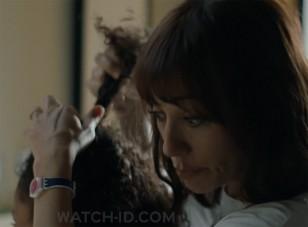Rashida Jones wears a Swatch Attraverso LW166 watch in the 2020 movie On The Rocks.