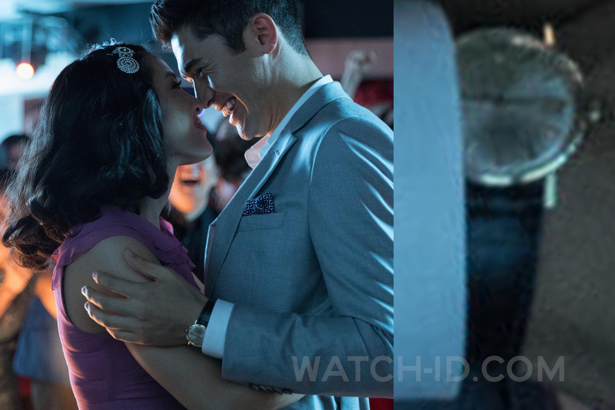 Henry Golding wears a vintage looking gold watch with black strap in Crazy Rich Asians (2018).